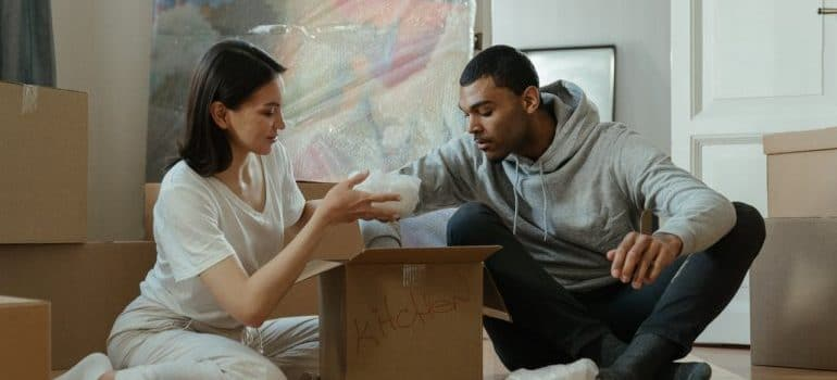 a couple with boxes