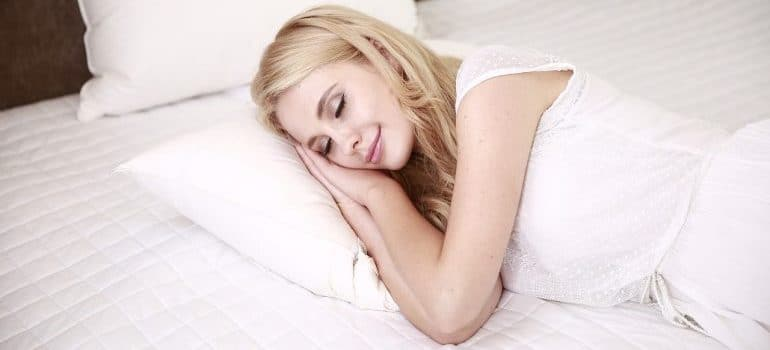 Woman peacefully asleep, knowing that Texas long distance movers are taking care of her relocation