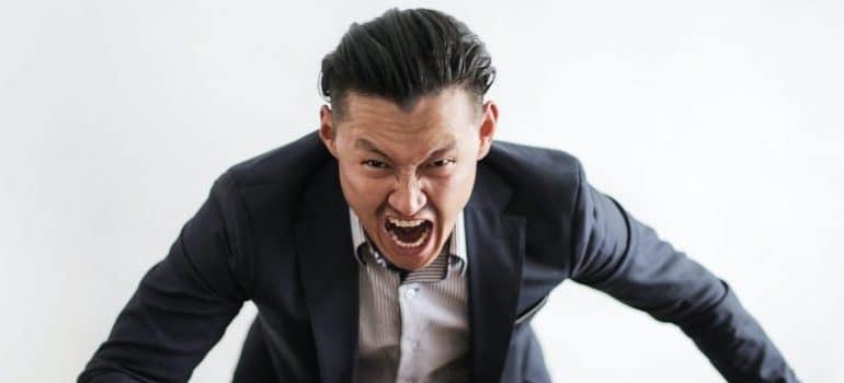 mad-formal-executive-man-yelling-at-camera