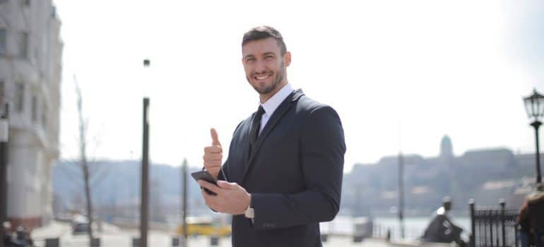 Businessman giving thumbs up for Kansas long distance movers