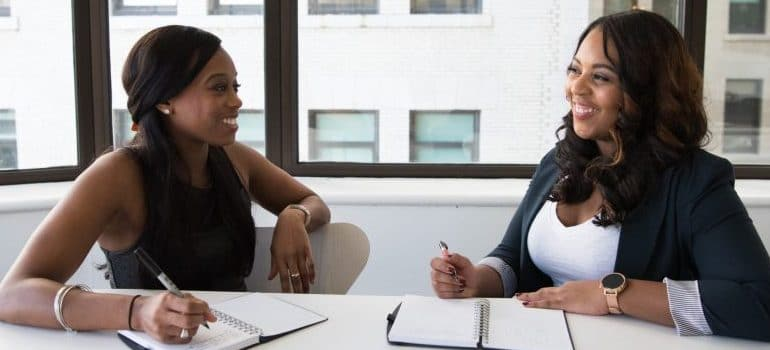 two women sitting in the office