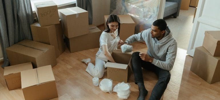 a couple packing a box