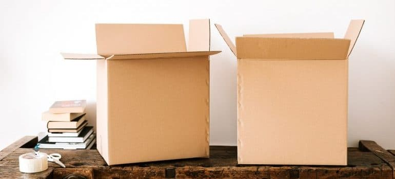 Open cardboard boxes on a wooden table.