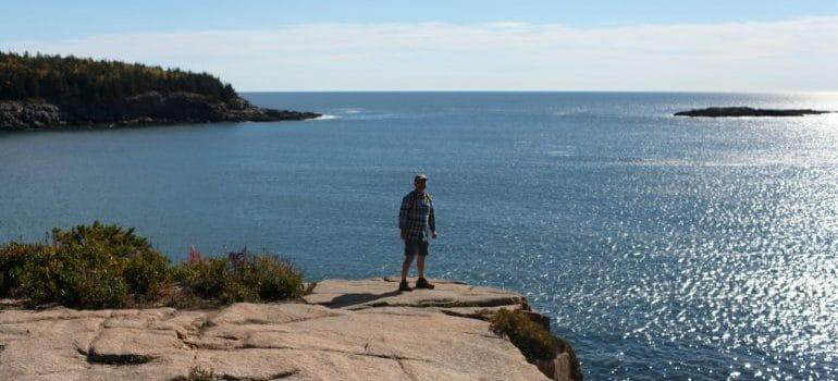 A man standing near the ocean