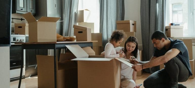 A family packing their household for a relocation.