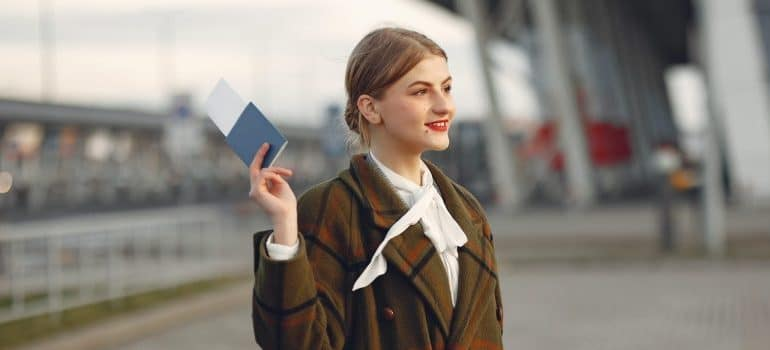 woman holding passport in her hand