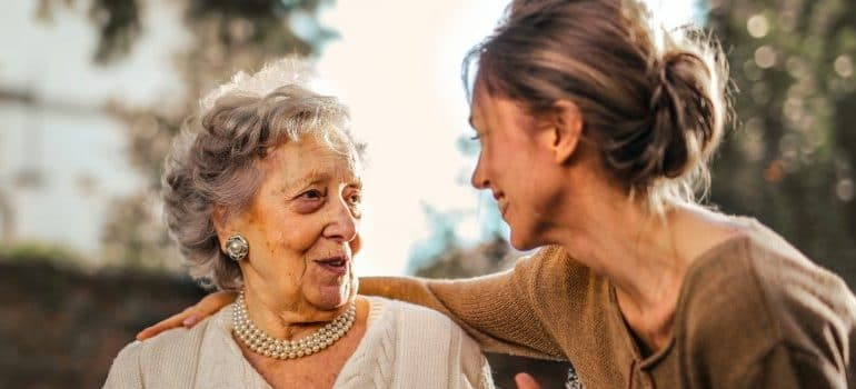 elderly woman and younger one talking