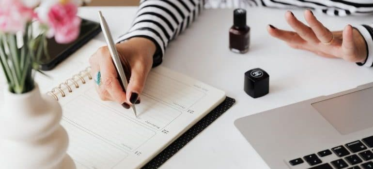 woman writing down her moving plan