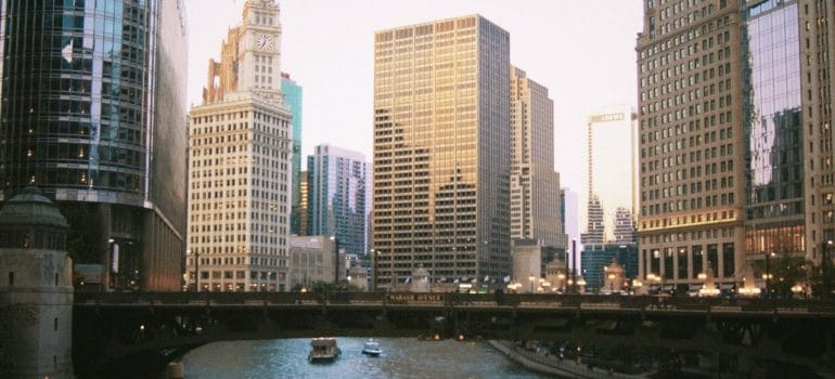 a view of a river going through the city of Chicago as a depiction of what to expect when moving to Illinois