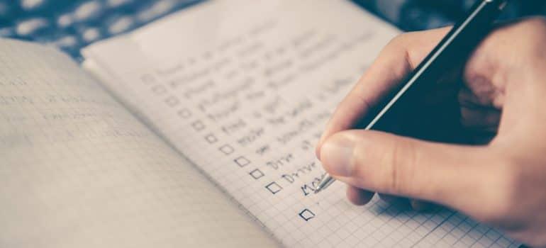 a person writting down their plans