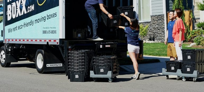 a couple waiting until a company delivers their moving containers before moving from Massachusetts to New Hampshire