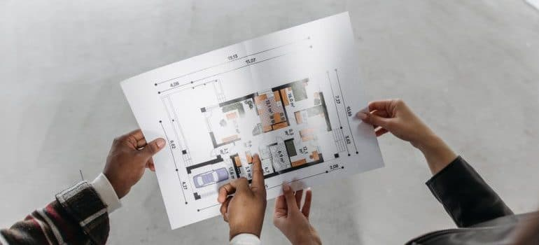 People holding a plan of a house