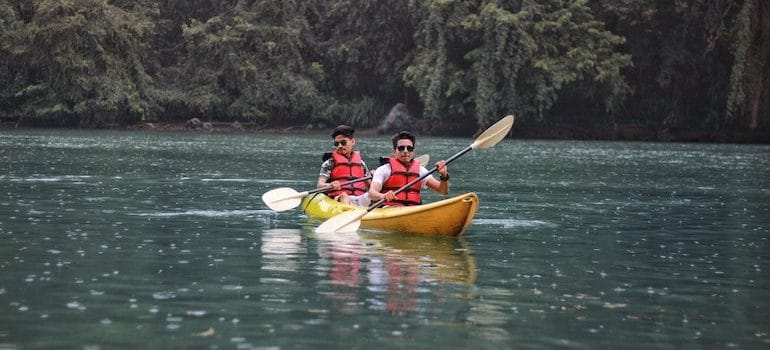 two man in a kayak on water is one of the reasons people move long distance 2021
